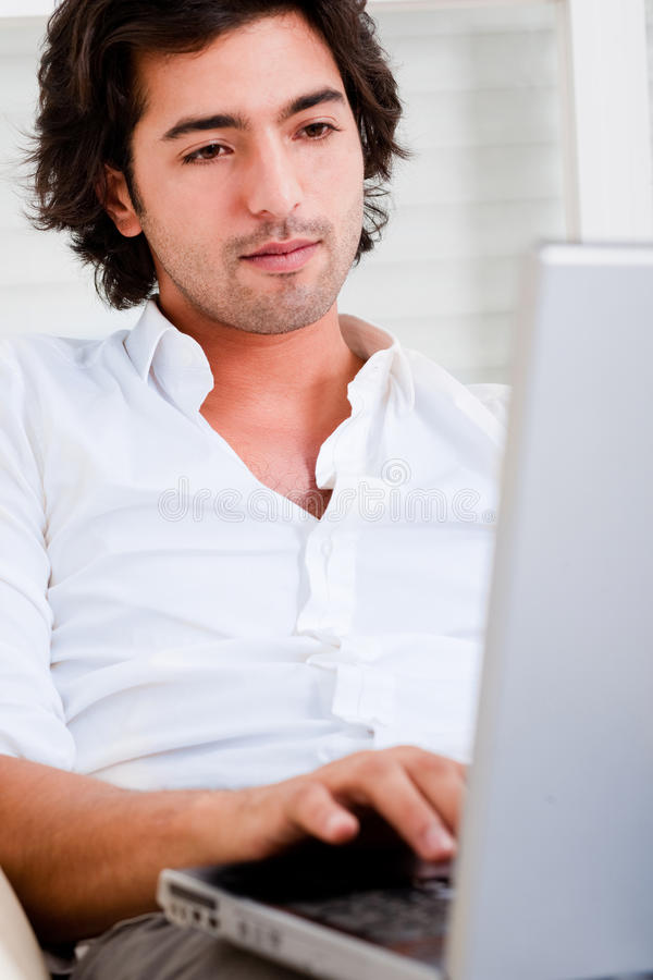 Attractive young man browsing the internet stock image
