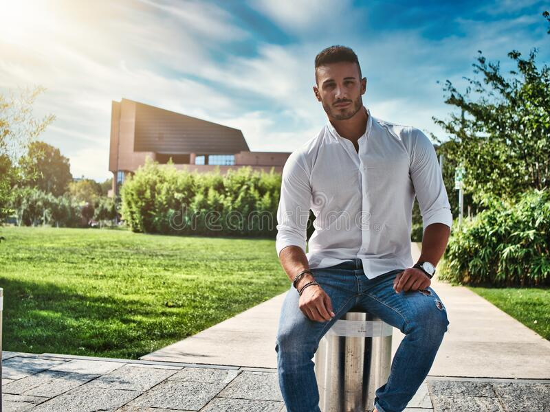 Attractive young man in a city park stock photography