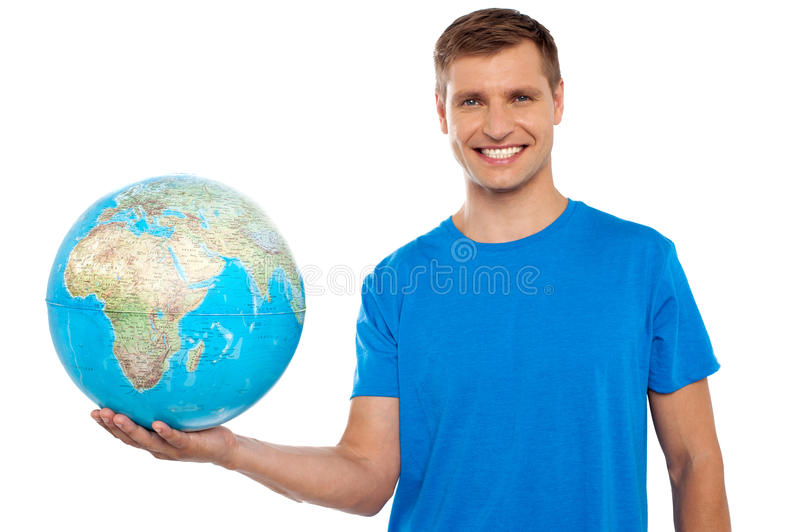 Download Attractive Young Man Holding Globe In His Hand Stock Image - Image: 26395447