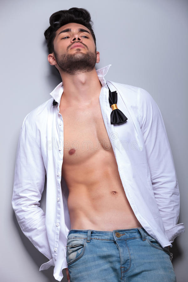 Attractive young man leaning back royalty free stock photos