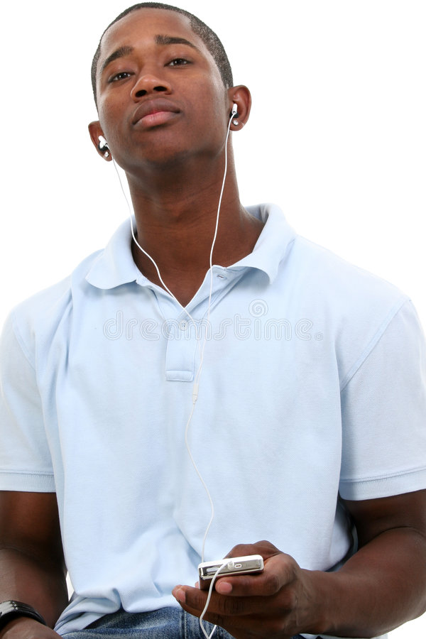 Attractive Young Man Listening To Headphones stock image
