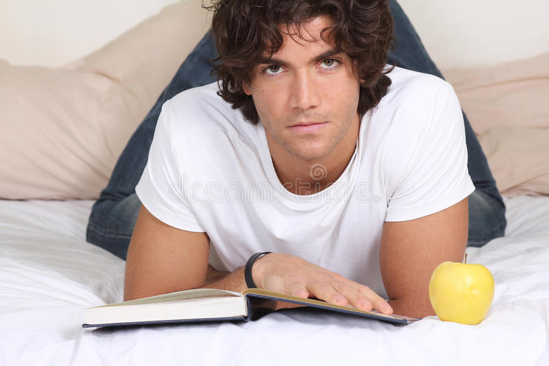 Download Attractive Young Man Read A Book Stock Image - Image: 22974183