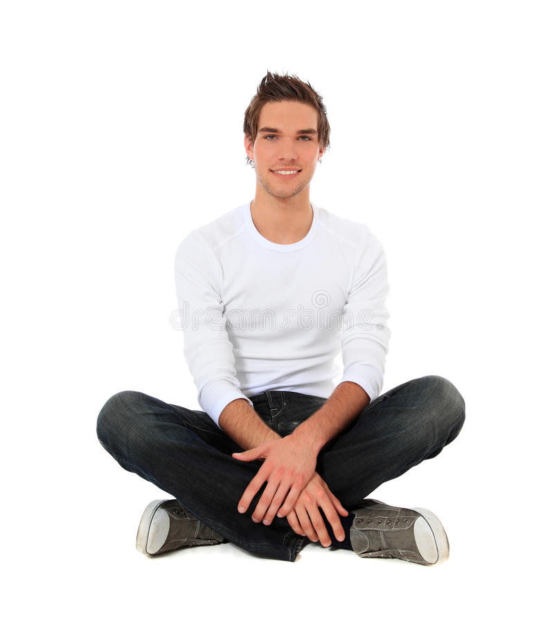 Download Attractive Young Man Sitting On The Floor Stock Image - Image: 19924097