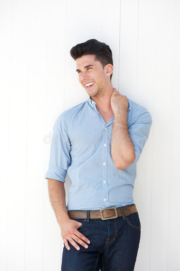 Download Attractive Young Man Smiling Against White Background Royalty Free Stock Photos - Image: 32435268