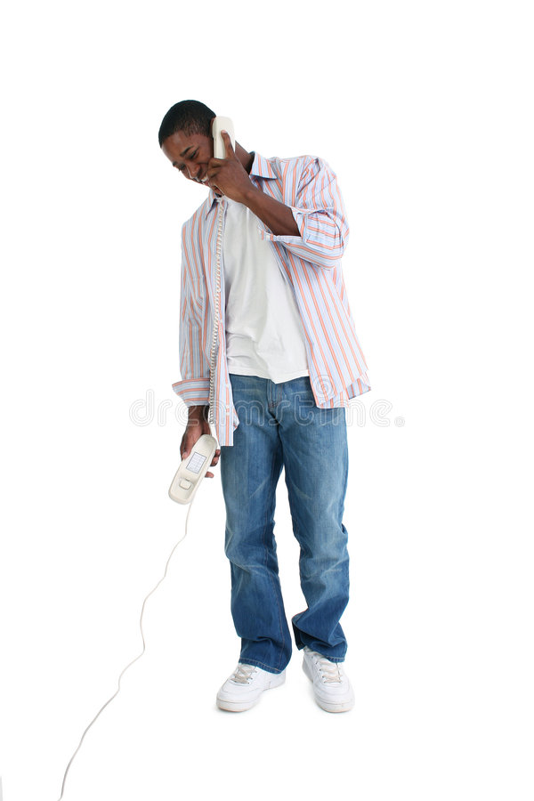Download Attractive Young Man Speaking On Telephone Stock Image - Image: 266165
