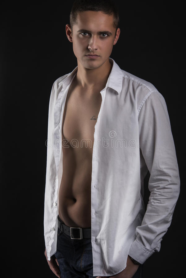 Young Man In White Shirt Stock Images