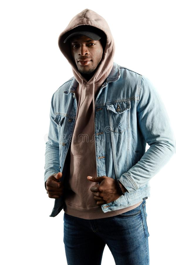 Attractive young man in stylish casual clothes looking at camera stock photo