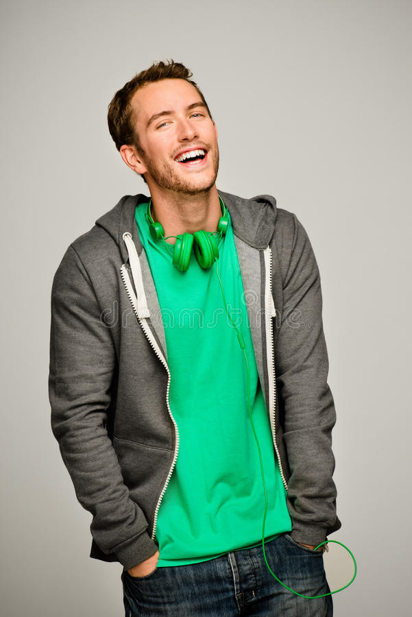 Attractive young man wearing hoodie smiling
