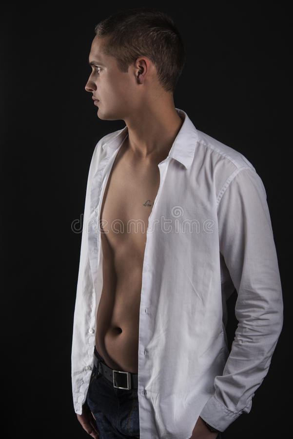 Download Sensual Young Man In White Shirt Standing In Profile Stock Photo - Image: 29938000