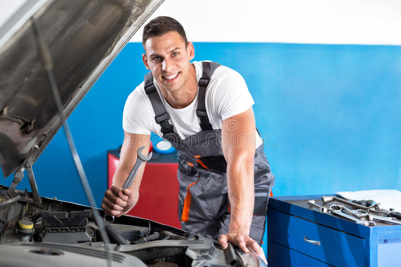 Attractive young mechanic royalty free stock photography