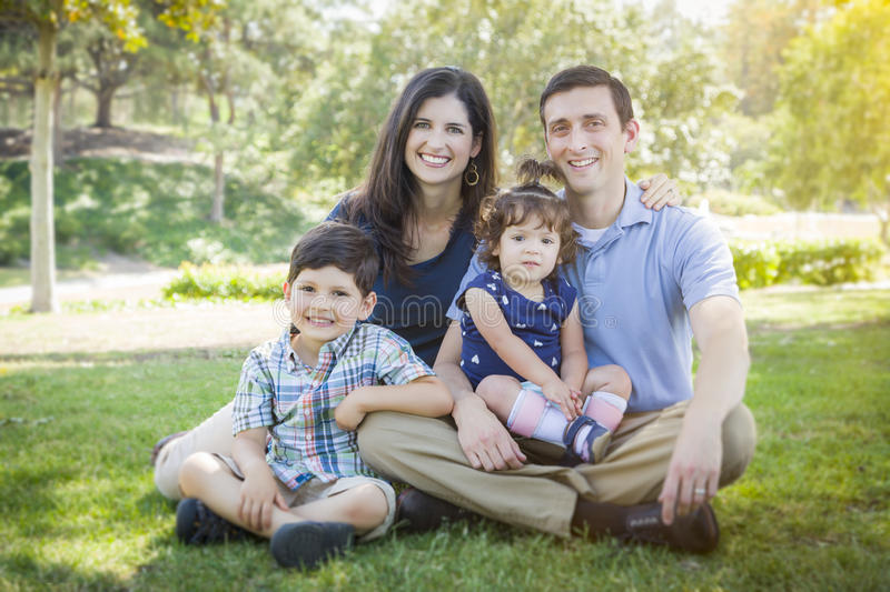 Attractive Young Mixed Race Family Outdoor Park Portrait royalty free stock image
