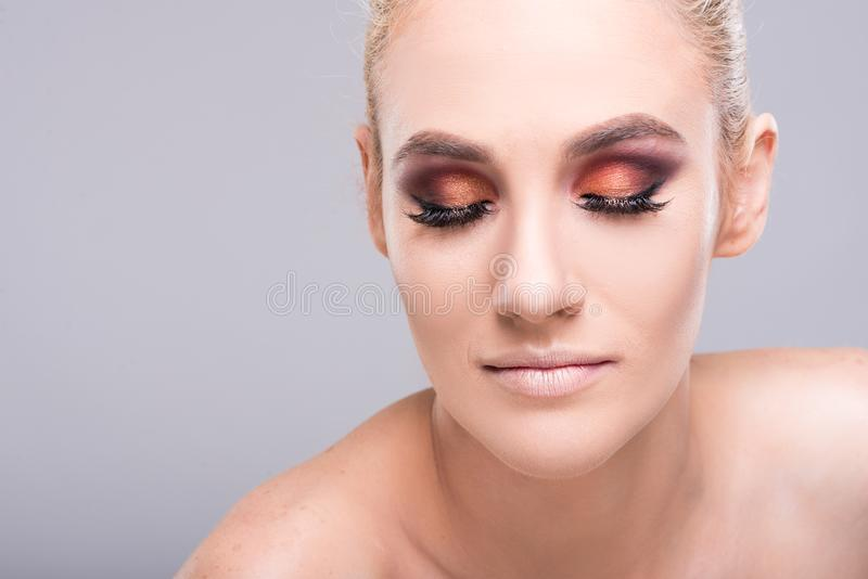Attractive young model posing wearing glam make-up royalty free stock photos