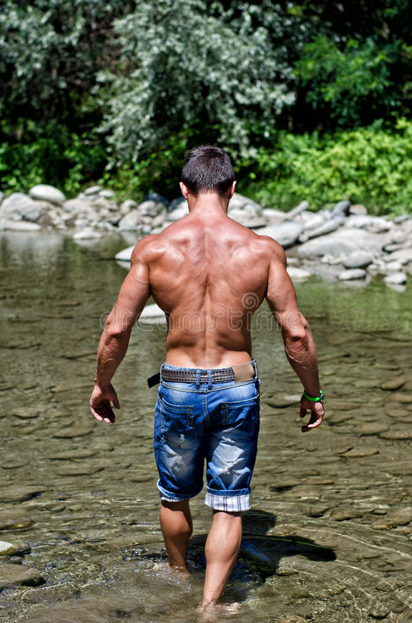 Handsome Fit Shirtless Young Man Next To Water Pond Or