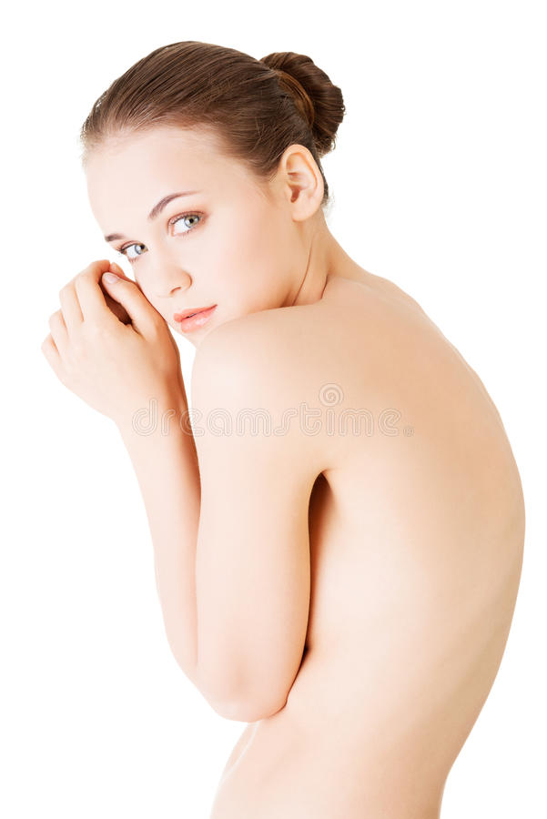 Attractive young naked woman. Side view. stock image