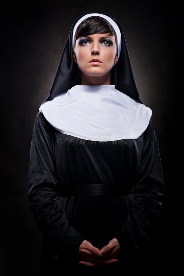 Attractive young nun royalty free stock photos
