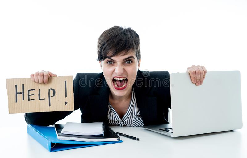 Attractive young overwhelmed and frustrated business woman worki stock image