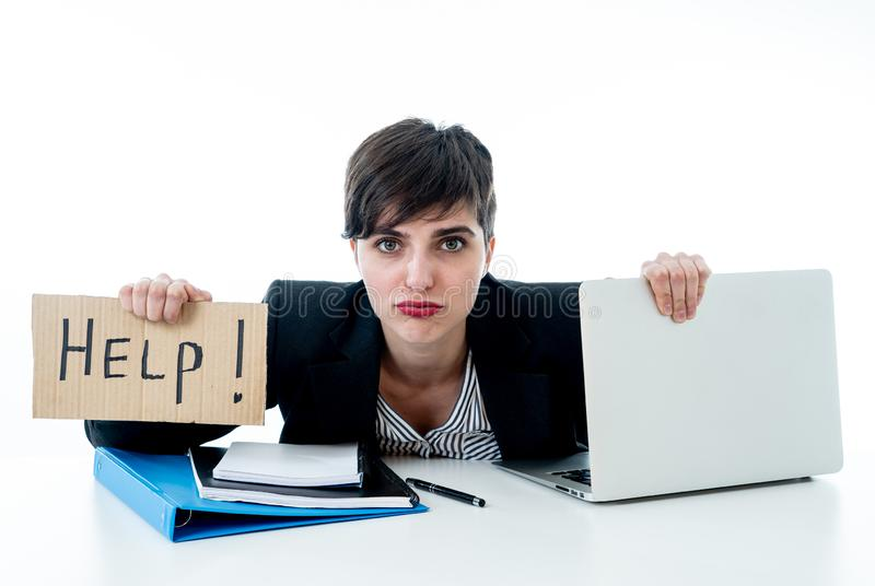 Attractive young overwhelmed and frustrated business woman working on her computer asking for help stock image