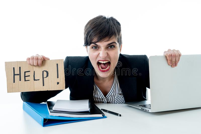 Attractive young overwhelmed and frustrated business woman working on her computer asking for help royalty free stock photo