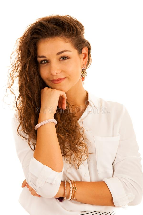 Attractive young pensive business woman smiling isolated over white background royalty free stock photo