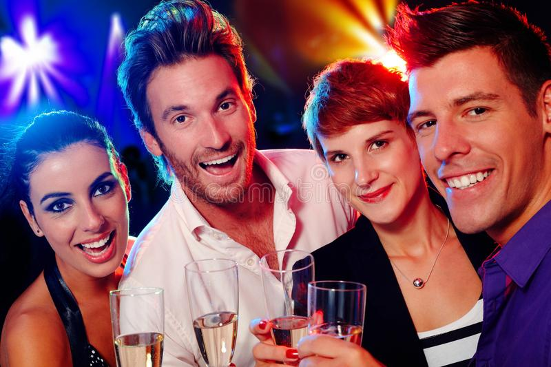 Attractive young people in nightclub. Attractive young people smiling happily in nightclub stock photos