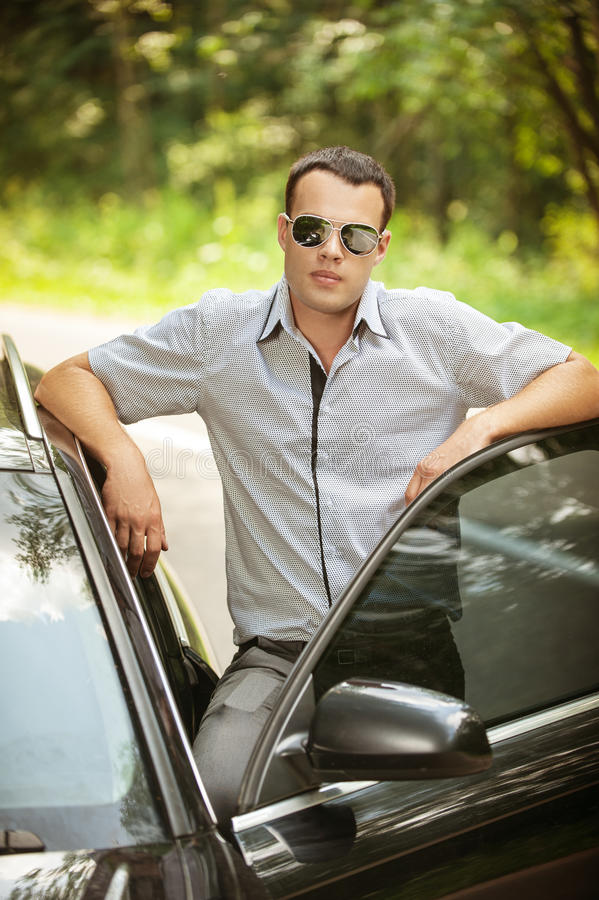 Attractive young serious man car stock photo