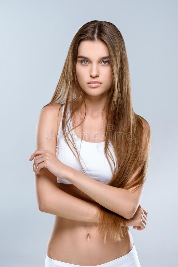 Attractive young slim woman stock image