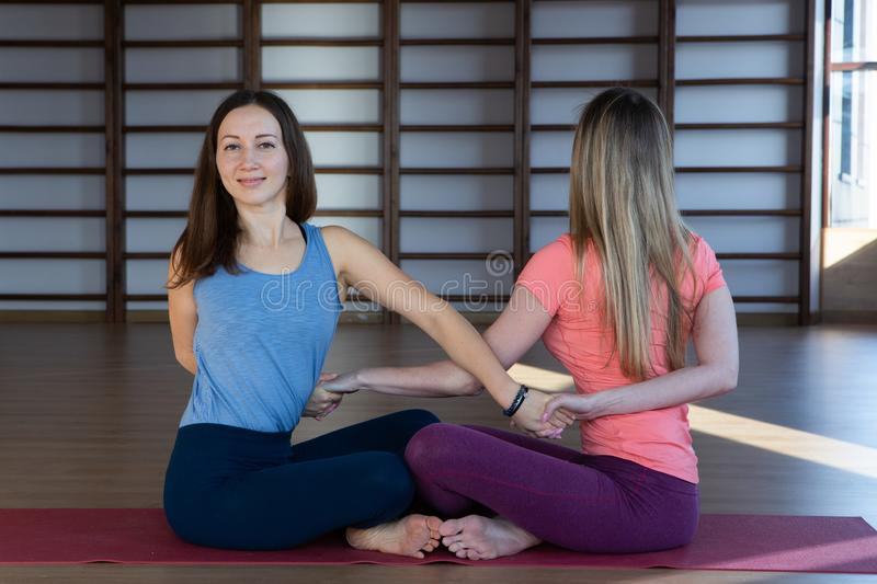 Attractive young sport girls are doing yoga together. Group training stock photography