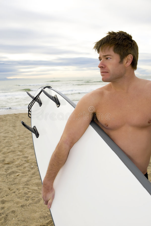 Attractive young surfer royalty free stock photography