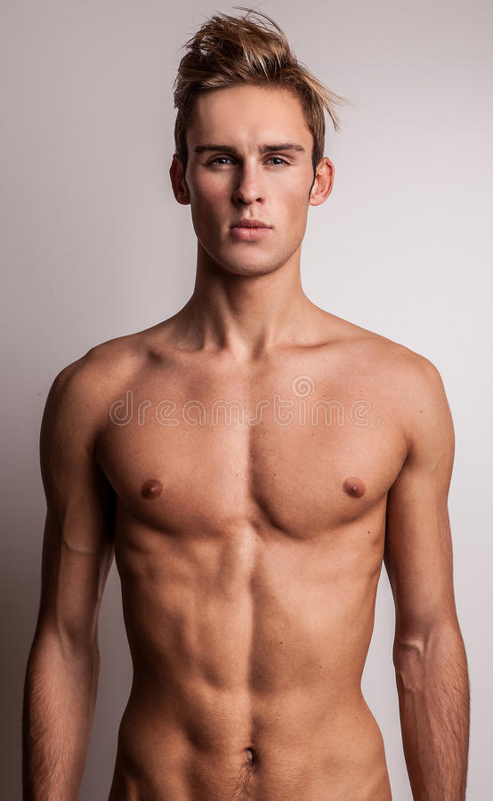 Attractive young undressed man model. royalty free stock photo