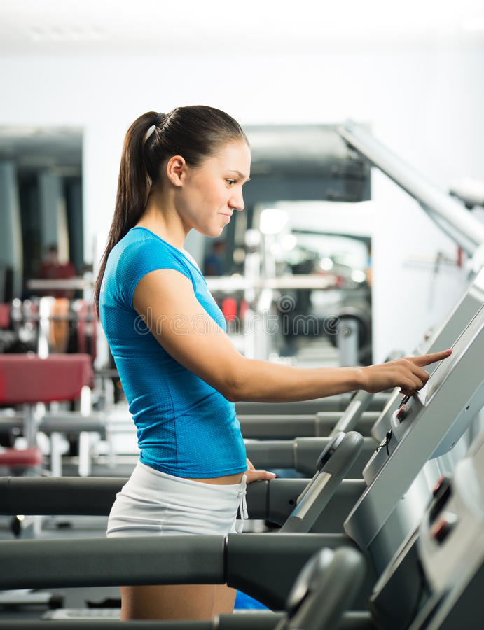 Download Attractive Young Woman Adjusts The Treadmill Stock Image - Image: 29528137
