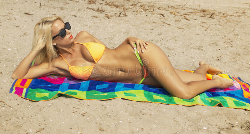 Attractive young woman on the beach royalty free stock photo