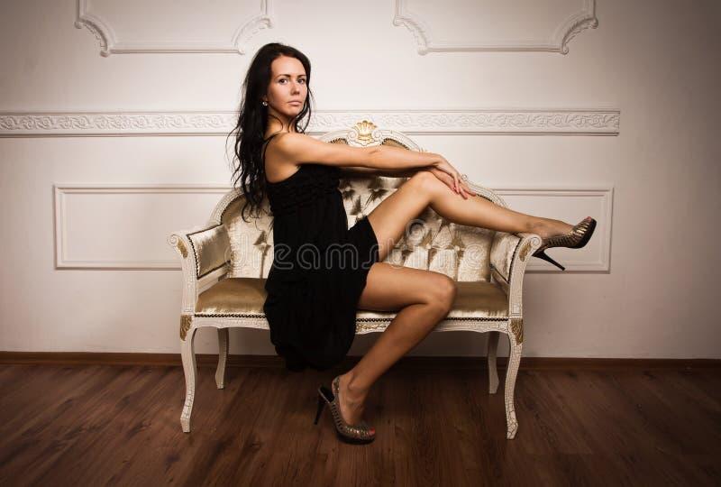 Attractive young woman in a boudoir stock photos