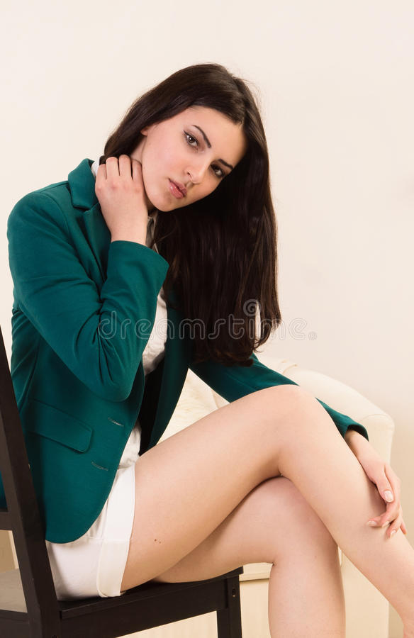 Attractive young woman in a boudoir stock images