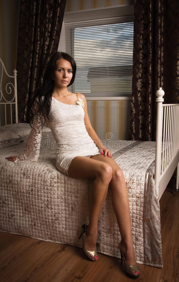 Attractive young woman in a boudoir stock photos