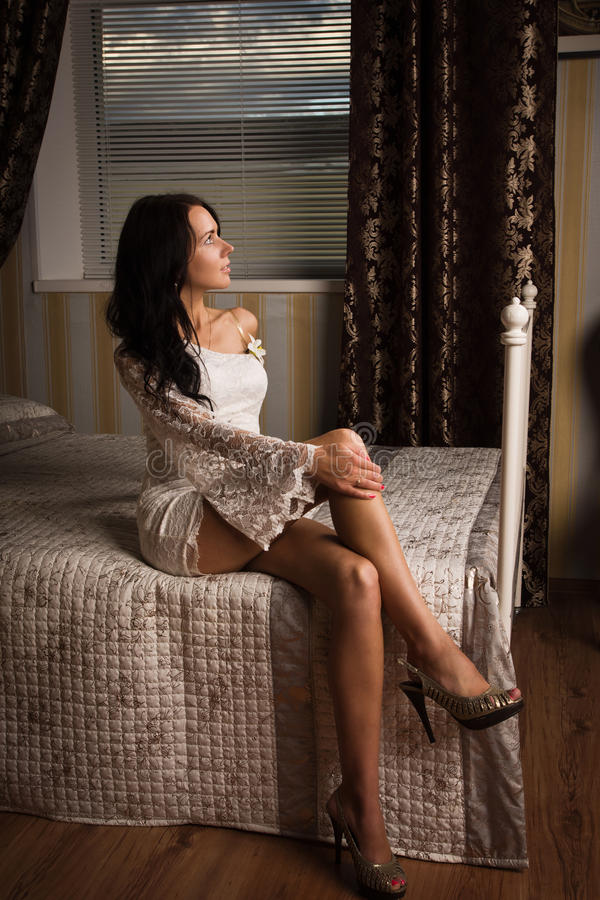 Attractive young woman in a boudoir royalty free stock image