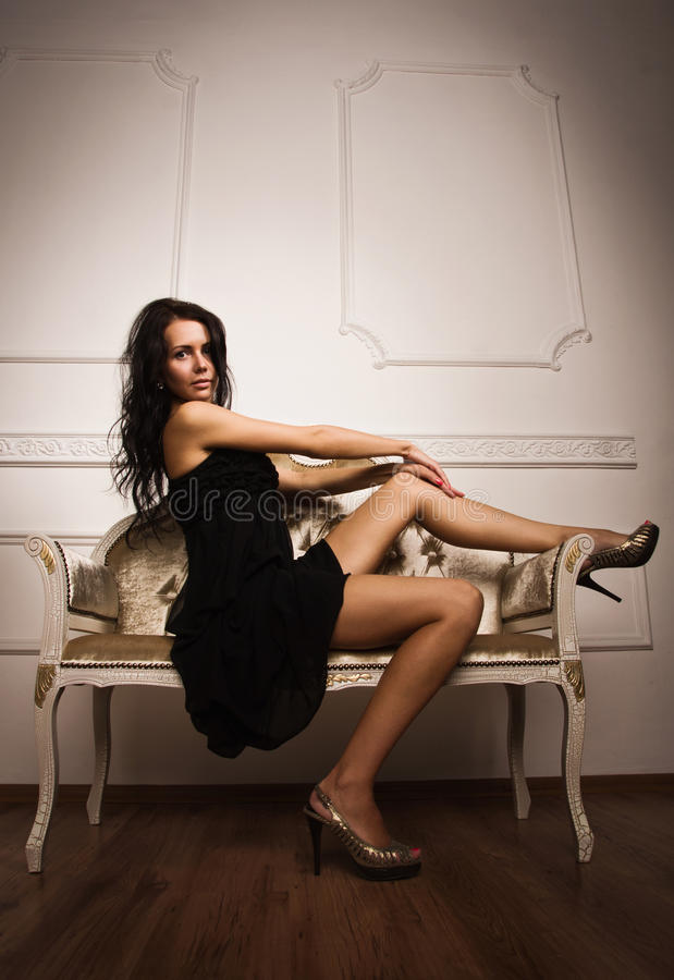 Attractive young woman in a boudoir royalty free stock photos