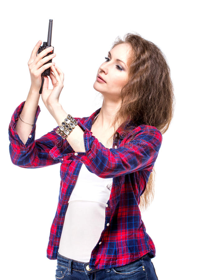 Download Attractive Young Woman In A Checkered Shirt With Walkie Talkie, Stock Photo - Image: 34197710
