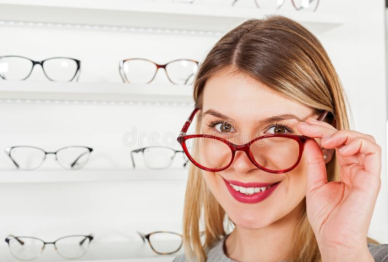 Woman Choosing Eyeglass Frame Stock Photo - Image of female, glass ...