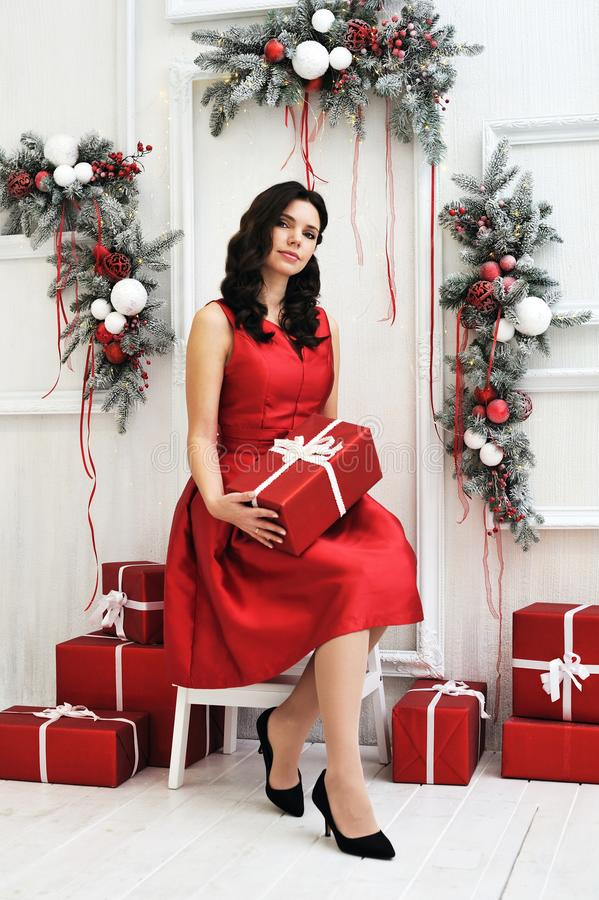 Attractive young woman with a christmas gift stock image