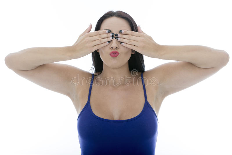 Attractive Young Woman Covering Her Eyes Pulling Faces. Isolated Against a White Background stock photos