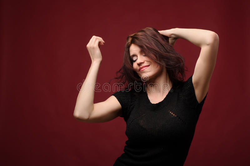 Attractive young woman dancing royalty free stock photo