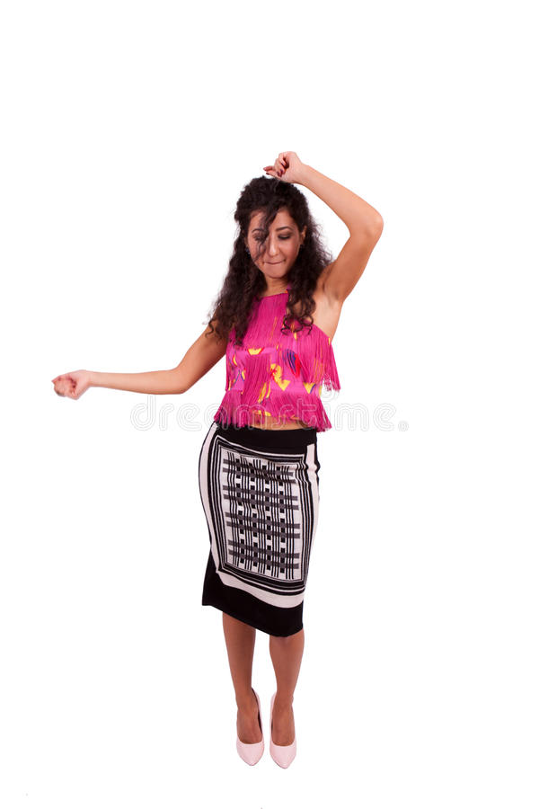 Attractive young woman dancing stock image