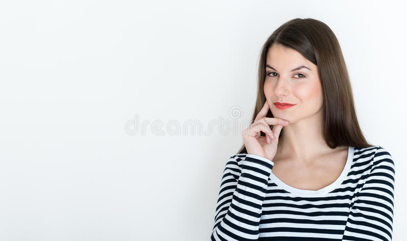 Attractive young woman deep in her thoughts stock photo