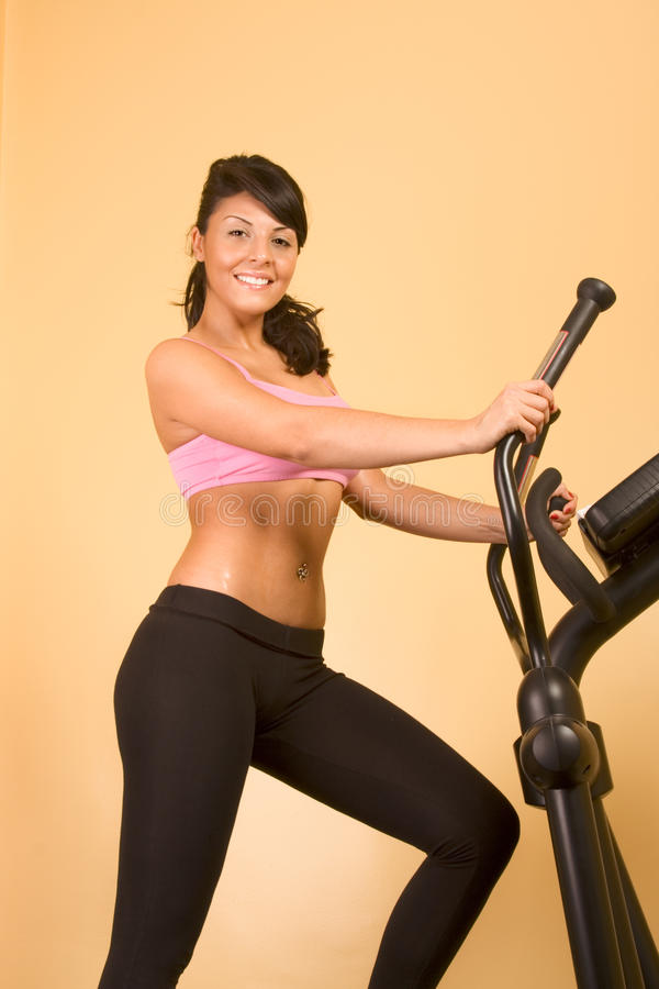Attractive young woman doing cardio workout royalty free stock photos