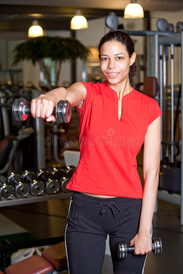 Attractive young woman doing fitness stock photography