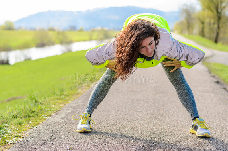 Attractive young woman doing a physical workout royalty free stock images