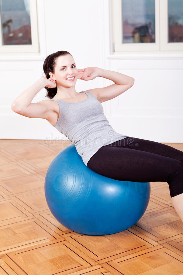 Download Attractive Young Woman Doing Sit Ups Stock Photo - Image: 30856842