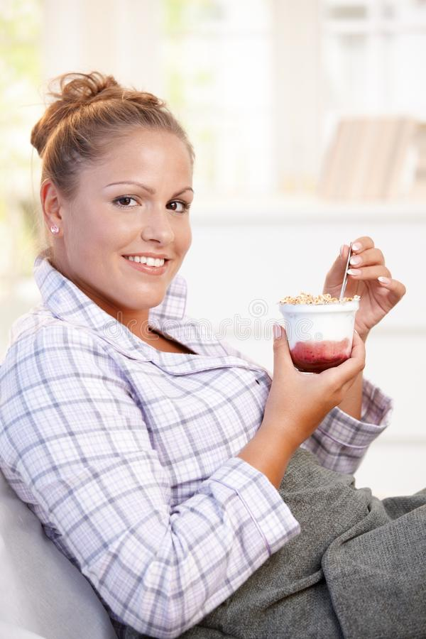 Download Attractive Young Woman Eating Yoghurt In Bed Stock Image - Image: 17164829