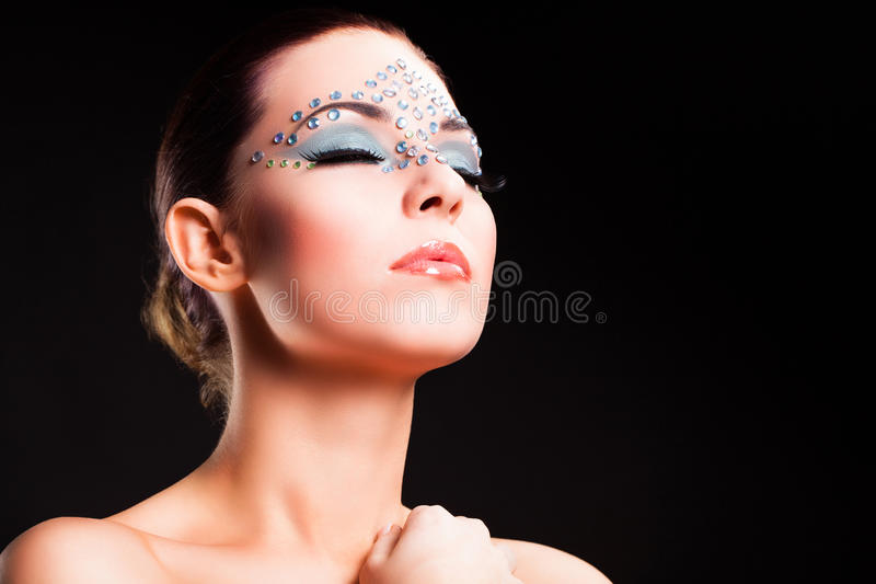 Attractive young woman with elegant make up stock images