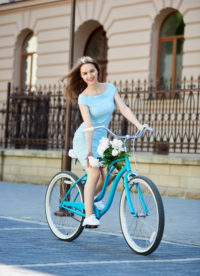Attractive young woman enjoying riding her bicycle royalty free stock images